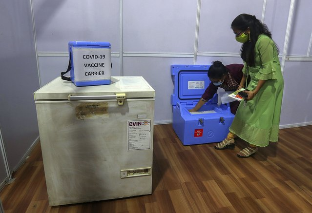 In this Thursday, January 7, 2021, file photo, health workers prepare for a trial run of COVID-19 vaccine, before preparing to roll-out an inoculation program to stem the coronavirus pandemic, in Mumbai, India.India took a regulatory shortcut for their homegrown vaccine, a move touted by Prime Minister Narendra Modi as a success in India's self-reliance. But several groups and unions representing scientists and doctors have expressed their concerns over scant evidence of effectiveness for the vaccine by Indian drugmaker Bharat Biotech. Many scientists have said that approving a vaccine without evidence from late trials is risky and a lack of transparency in the approval process could increase vaccine hesitancy in the world's second-most populated country, where more than 10.4 million coronavirus cases have been reported among the nearly 1.4 billion people. (Photo by Rafiq Maqbool/AP Photo/File)