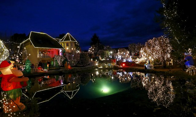A general view shows the Christmas decoration at a country house estate in the village of Bad Tatzmannsdorf, Austria, November 30, 2015. The estate owned by the Gollnhuber family is lit with half a million Christmas lights and more than 60 inflatable Christmas figures, turning the place into a winter wonderland every December and attracting thousands of visitors. (Photo by Leonhard Foeger/Reuters)