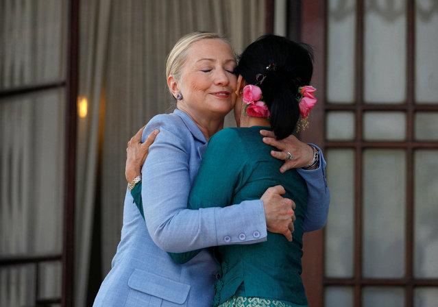 U.S. Secretary of State Hillary Clinton (L) hugs Myanmar's pro-democracy leader Aung San Suu Kyi as they meet at Suu Kyi's house in Yangon December 2, 2011. (Photo by Soe Zeya Tun/Reuters)