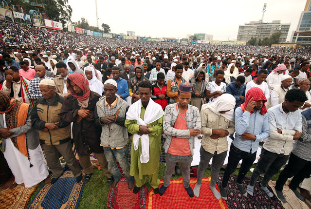 Muslims attend Eid al-Fitr prayers in Addis Ababa, Ethiopia on June 15, 2018. (Photo by Tiksa Negeri/Reuters)