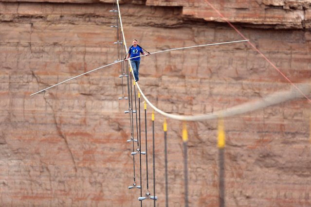 Nik Wallenda walks across a 2-inch wire 1500 feet above the ground to cross the Grand Canyon for Skywire Live With Nik Wallenda on the Discovery Channel, Sunday, June 23, 2013 at the Grand Canyon, Calif. (Photo by Tiffany Brown/AP Images for Discovery Communications)