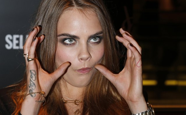 Model Cara Delevingne poses during a photo call at Selfridges department store in London January 20, 2015. (Photo by Suzanne Plunkett/Reuters)