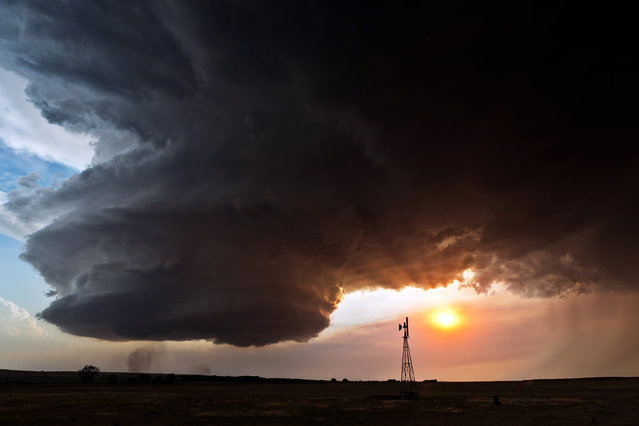 Supercell with windmill, Chappell Nebraska in 2012. (Photo by Camille Seaman/Caters News)