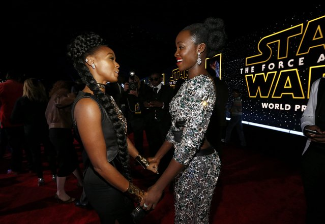 "Actress Lupita Nyong'o (R) and singer Janelle Monae chat as they arrive at the premiere of ""Star Wars: The Force Awakens"" in Hollywood, California December 14, 2015. (Photo by Mario Anzuoni/Reuters)"
