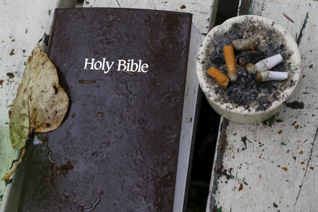 A bible and ashtray filled with cigarettes are seen at SHARE/WHEEL Tent City 4 outside Seattle, Washington October 9, 2015. SHARE and WHEEL describe themselves as self-organised, democratic organisations of homeless and formally homeless people which run several self-managed tent cities. At homeless encampments from Seattle, Washington state to Las Cruces, New Mexico, residents live away from the dangers of life on the streets, saying the stability helps them work towards their goals. (Photo by Shannon Stapleton/Reuters)