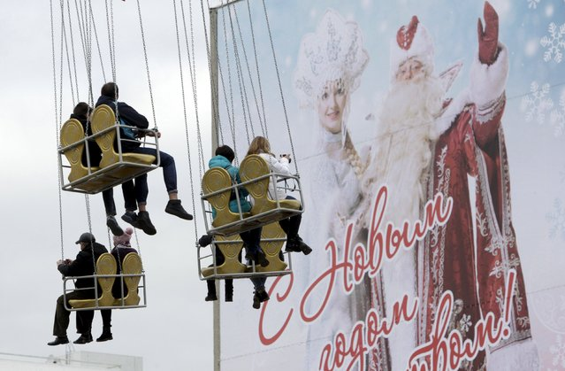 People take a ride during a festive pre-holiday procession of participants, dressed as Ded Moroz, his granddaughter Snegurochka and other characters, in Krasnodar, southern Russia, December 19, 2015. (Photo by Eduard Korniyenko/Reuters)