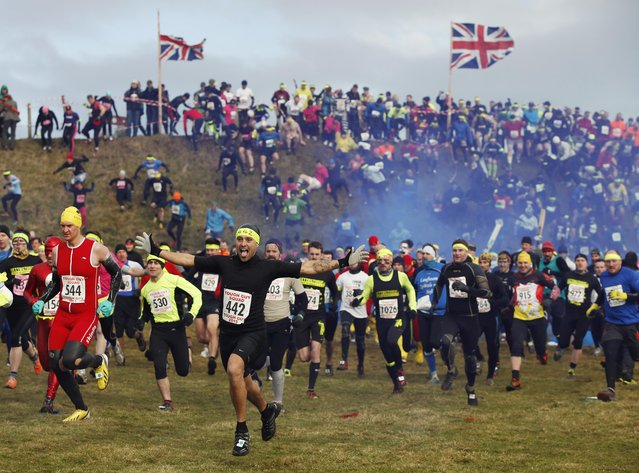 Competitors gesture as they start the Tough Guy event in Perton, central England February 1, 2015. (Photo by Phil Noble/Reuters)