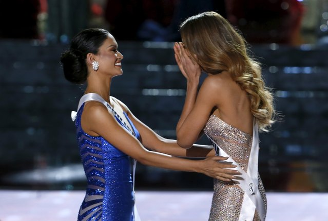Miss Philippines Pia Alonzo Wurtzbach (L) congratulates Miss Colombia Ariadna Gutierrez as Miss Colombia was initially announced as Miss Universe during the 2015 Miss Universe Pageant in Las Vegas, Nevada, December 20, 2015. Host Steve Harvey said he made a mistake when reading the card and Miss Philippines Pia Alonzo Wurtzbach is the actual winner. (Photo by Steve Marcus/Reuters)