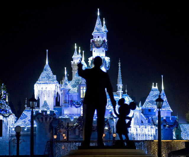 "This November 20, 2009 photo shows Sleeping Beauty's Castle in winter dress with the iconic ""Partners"" statue featuring images of Walt Disney and Mickey Mouse in the foreground, at Disneyland in Anaheim, Calif. (Photo by H. Lorren Au Jr./AP Photo/The Orange County Register)"