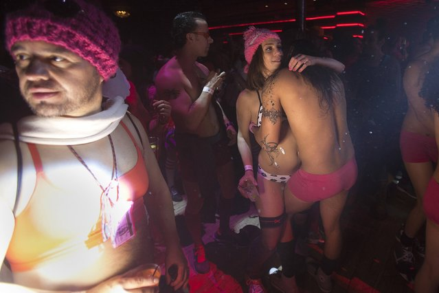 People dance and party before taking part in the Cupid's Undie Run in the Manhattan borough of New York February 7, 2015. (Photo by Carlo Allegri/Reuters)