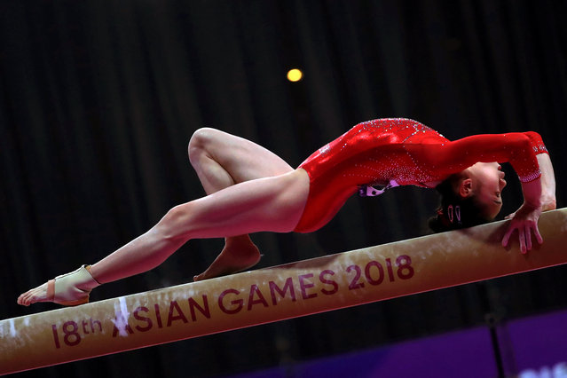 Tingting Liu of China performs on the Balance Beam during the women's Gymnastics qualification round at the Asian Games 2018 in Jakarta, Indonesia, 21 August 2018. (Photo by Mast Irham/EPA/EFE)