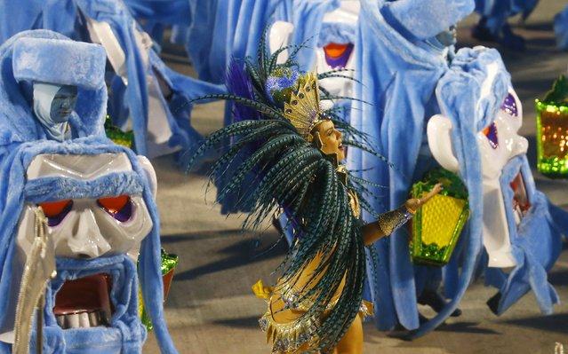 Revellers from the Grande Rio samba school participate in the annual carnival parade in Rio de Janeiro's Sambadrome, February 16, 2015. (Photo by Ricardo Moraes/Reuters)