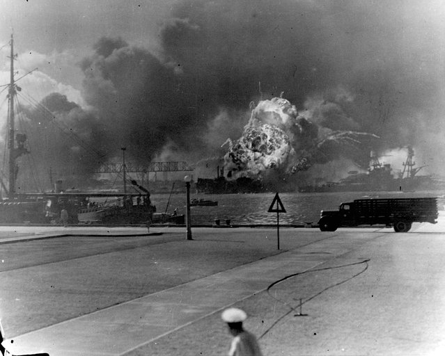 The forward magazines of the destroyer USS Shaw explode after a bombing attack by Japanese planes on Pearl Harbor, Hawaii, U.S. December 7, 1941. (Photo by Reuters/U.S. Naval History and Heritage Command)