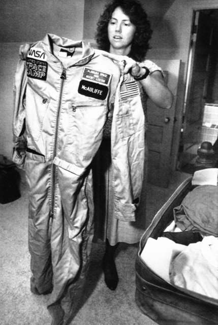 High school teacher Christa McAuliffe folds her training uniform as she packs for Houston in Concord, September 8, 1985. McAuliffe will leave on Sunday for NASA training for her January flight aboard the space shuttle as the first private citizen to ride in space. (Photo by Jim Cole/AP Photo)