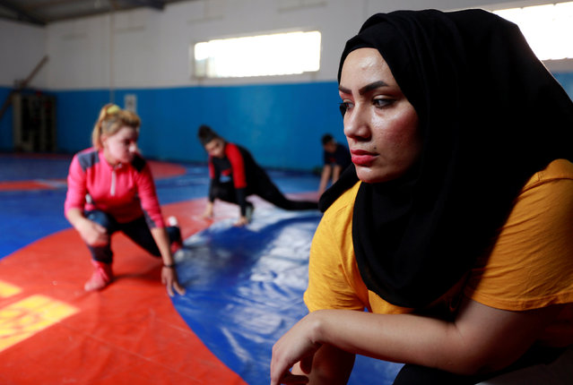 "Alia Hussein, of Iraq's first women's wrestling squad, exercises during practice at the sports club in Diwaniya, Iraq on November 10, 2018. The toughest fight that Hussein ever faced was convincing her family that women should be allowed to grapple. The 26-year-old student was a keen cyclist and basketball player but when she told her family last year that she wanted to try her hand at the physical world of wrestling she was met with abuse. ""I was humiliated and even beaten by my family, but I defied them all,"" Hussein told Reuters. ""I feel that I can express myself through this sport. I wanted to prove to society that wrestling is not confined to men only and that Iraqi women can be wrestlers and can win and fight"". (Photo by Alaa Al-Marjani/Reuters)"