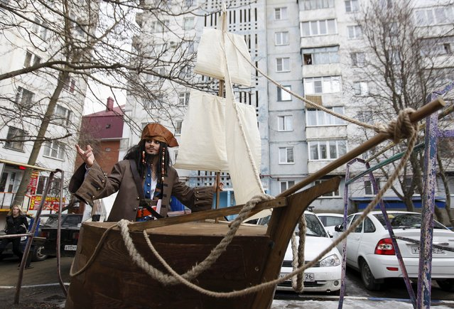 German Yesakov, 25, a cameraman from Russia, stands on a lifting platform decorated as a sailing ship dressed as movie character Captain Jack Sparrow, during his wedding ceremony in the southern city of Stavropol, Russia, February 5, 2016. (Photo by Eduard Korniyenko/Reuters)