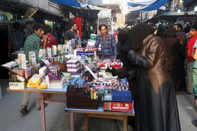 Women shop ahead of the Muslim festival of Eid-al-Adha in Aleppo, Syria September 23, 2015. (Photo by Hamid Khatib/Reuters)