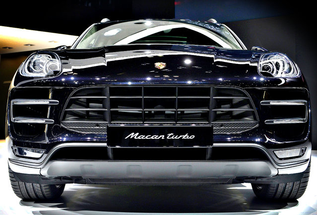The Porsche Macan Turbo is presented at the 43rd Tokyo Motor Show 2013 in Tokyo, Japan, 20 November 2013. The 43rd Tokyo Motor Show 2013 will be open to the public from 22 November to 01 December 2013. (Photo by Franck Robichon/EPA)