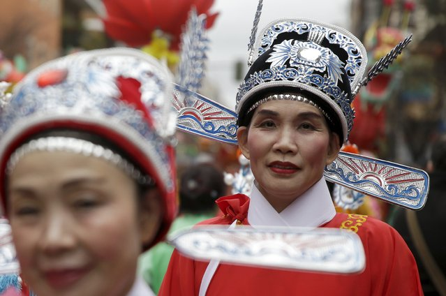 Women wear traditional costumes during a parade to celebrate the Chinese Lunar New Year, which welcomes the Year of the Monkey, in Madrid, Spain, February 13, 2016. (Photo by Andrea Comas/Reuters)
