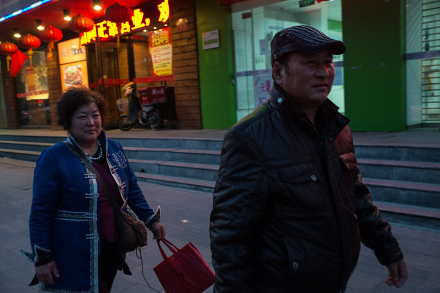 Sarengaowa, left, and Aodengfu, Mongols from Urad Banner, walk in Beijing, where they came with fellow herders to petition the government about abuses by mineral interests. Sarengaowa was detained for 15 days for participating in a similar protest in 2013. (Photo by Gilles Sabrie/The Washington Post)