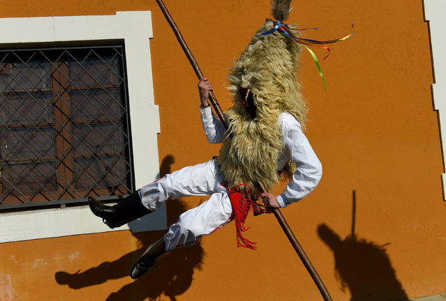 "A villager jumps during ""Los Sidros y Las Comedias"", a traditional festival in Spain's northern village of Valdesoto, January 8, 2017. (Photo by Eloy Alonso/Reuters)"