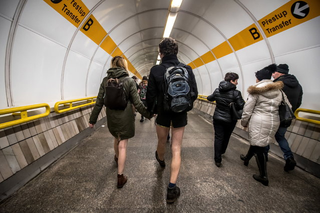 "Young people wearing no pants participate in the ""No Pants Subway Ride"" in Prague, Czech Republic, 13 January 2019. (Photo by Martin Divisek/EPA/EFE)"