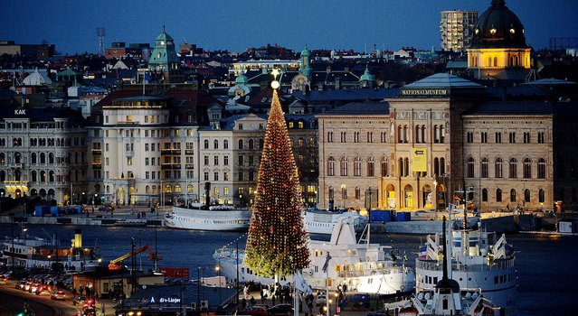 A 36-meter tall traditional Christmas tree is lit up in Stockholm. (Photo by Johan Nilsson/TT News Agency)