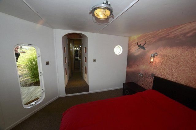 Owner Toby Rhys-Davies looks into the bedroom area built attached to a luxury Jetstar private jet, built in the seventies and retaining most of the original features which is now being used as a holiday let in Redberth, Pembrokeshire, Wales, January 11, 2017. (Photo by Rebecca Naden/Reuters)