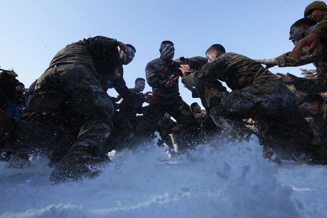 U.S. Marines from 3rd Marine Expeditionary force deployed from Okinawa, Japan, participate in the winter military training exercise with South Korean soldiers on January 24, 2017 in Pyeongchang-gun, South Korea. U.S. and South Korean marines participate in the endurance exercise in temperature below minus 20 degrees celsius under a scenario to defend the country from any possible attacks from North Korea. (Photo by Chung Sung-Jun/Getty Images)