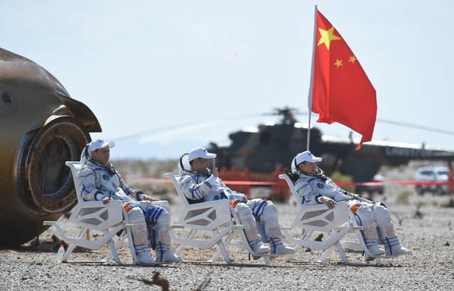 Astronauts Nie Haisheng (C), Liu Boming (R) and Tang Hongbo are out of the return capsule of the Shenzhou-12 spaceship at the Dongfeng landing site in north China's Inner Mongolia Autonomous Region on September 17, 2021. Three Chinese astronauts, the first sent to orbit for space station construction, have completed their three-month mission and returned to Earth safely on Friday. Photo by Lian Zhen/Xinhua News Agency)