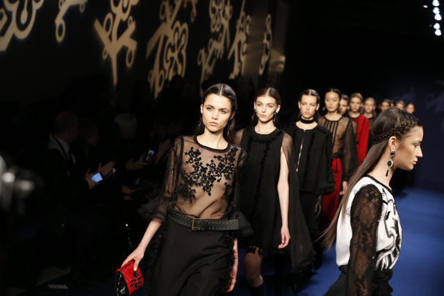 Models wear creations for Singapore-born, Paris-based fashion designer Andrew GN's Fall-winter 2016-2017 ready to wear collection presented in Paris, France, Friday, March 4, 2016. (Photo by Francois Mori/AP Photo)
