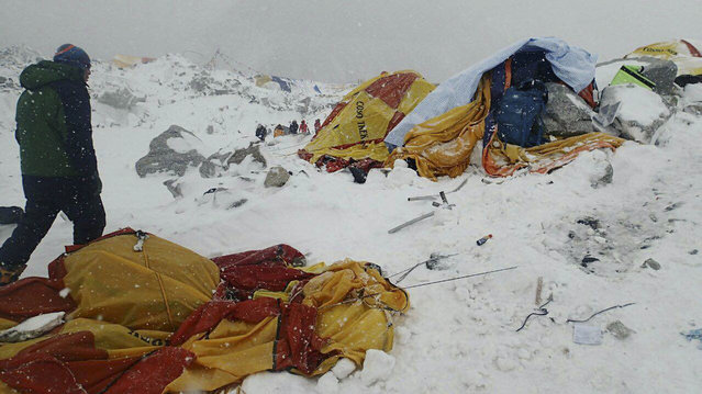In this photo provided by Azim Afif a man approaches the scene after an avalanche triggered by a massive earthquake swept across Everest Base Camp, Nepal on Saturday, April 25, 2015. Afif and his team of four others from the Universiti Teknologi Malaysia (UTM) all survived the avalanche. (Photo by Azim Afif/AP Photo)