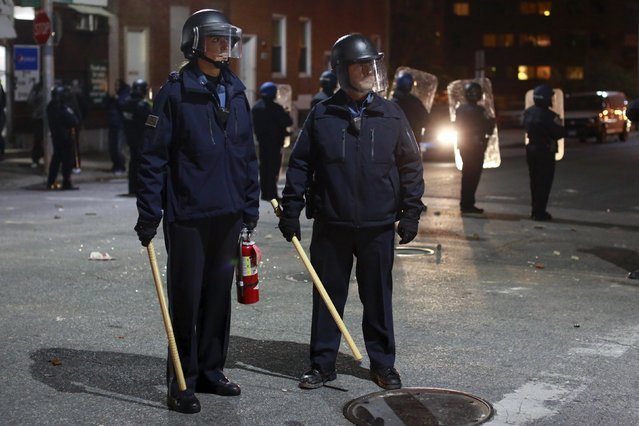 Baltimore police department officers stand guard during a rally to protest the death of Freddie Gray who died following an arrest in Baltimore, Maryland April 25, 2015. (Photo by Shannon Stapleton/Reuters)