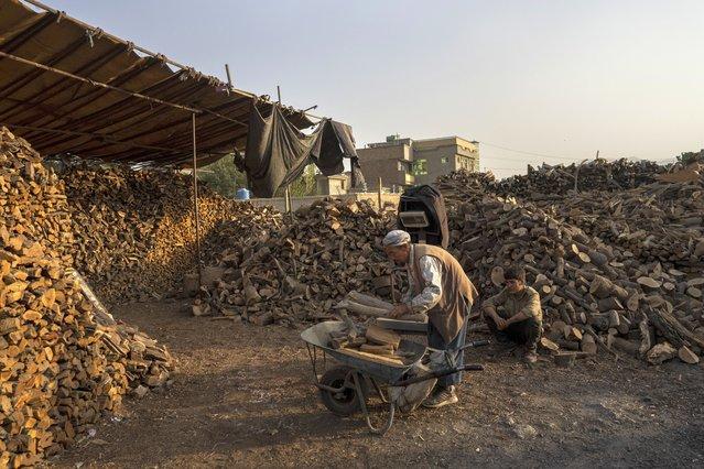 An Afghan man buys firewood in Kabul, Afghanistan, Monday, September 20, 2021. (Photo by Bernat Armangue/AP Photo)
