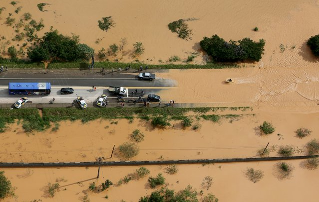 A flooded road is seen in the city of Franco da Rocha, in the north of Sao Paulo state, Brazil, March 11, 2016. (Photo by Paulo Whitaker/Reuters)