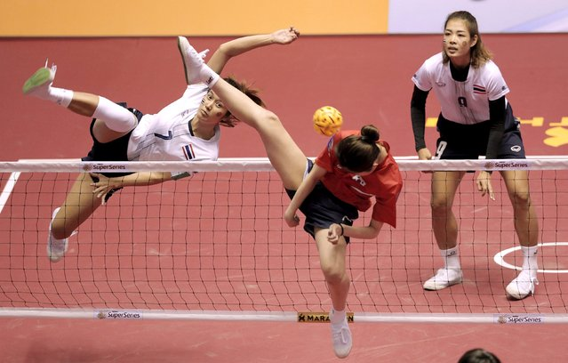Sepak Takraw – ISTAF Super Series Korea 2014-15 – Gunsan City, South Korea April 26, 2015: Korea's Heon Gyu Me (C) in action during the Women's final. (Photo by Jeremy Lee/Reuters)
