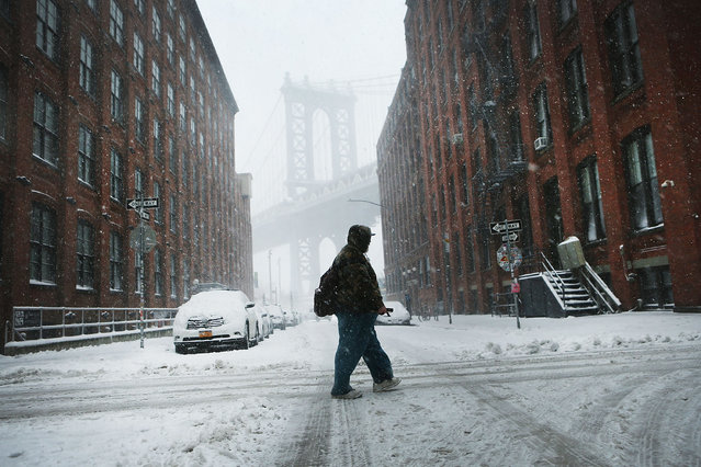 A pedestrian make his way through the snow and wind on February 9, 2017 in the Brooklyn borough of New York City. (Photo by Spencer Platt/Getty Images)