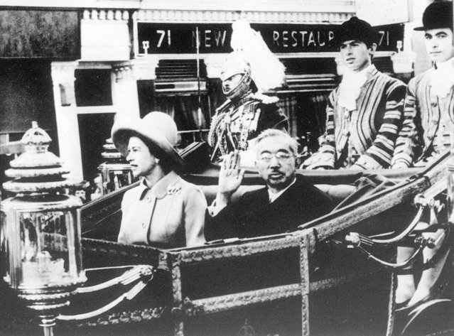 """In this October 5, 1971, photo, Emperor Hirohito, center right, and Queen Elizabeth II, center left, are in carriage on their way to the Buckingham Palace as part of his tour to Europe. The Japanese Emperor Akihito's expression of """"deep remorse"""" for World War II is in keeping with what by all appearances has become his mission: to make amends for a war fought in the name of his father, Hirohito. For the last time in his 30-year reign, Emperor Akihito addressed an annual memorial service Wednesday, Aug. 15, 2018, marking the end of World War II. (Photo by Kyodo News via AP Photo)"""