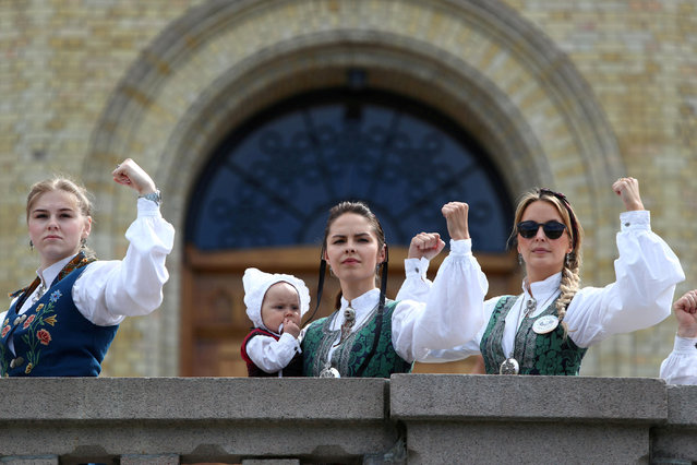 People wearing 'Bunad', regional Norwegian costumes, protest against health welfare cuts, at the districts in front of the parliament in Oslo, Norway May 14, 2019. (Photo by Vidar Ruud/NTB Scanpix via Reuters)