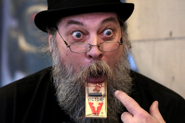 """Performer James """"Gentleman Jim"""" Stilianos displays a mousetrap attached to his tongue at Ripley's Believe It or Not! Times Square Odditorium during celebrations for World Sword Swallower's Day in Manhattan, New York, U.S., February 25, 2017. (Photo by Andrew Kelly/Reuters)"""