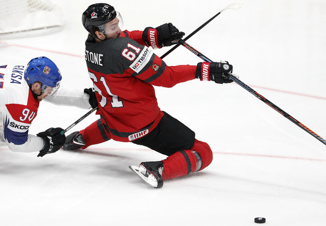 Czech Republic's Radek Faksa, left, challenges Canada's Mark Stone during the Ice Hockey World Championships semifinal match between Canada and Czech Republic at the Ondrej Nepela Arena in Bratislava, Slovakia, Saturday, May 25, 2019. (Photo by Petr David Josek/AP Photo)