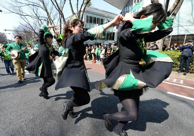 Japanese youths dance on the street during the 22nd St Patrick's Day Parade at Omotesando fashion district in Tokyo on March 16, 2014. Some 1,000 people took part in the annual parade. (Photo by Toru Yamanaka/AFP Photo)