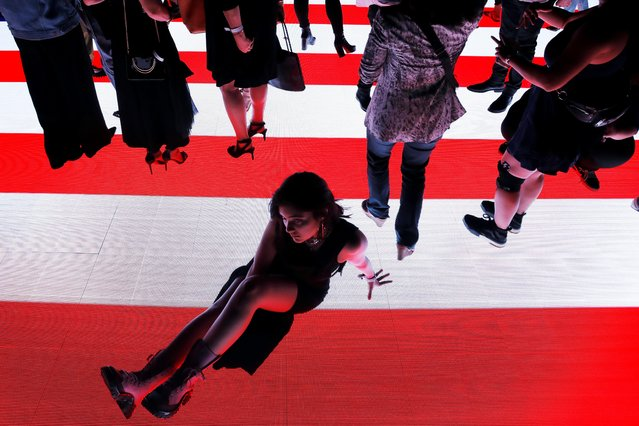 "Attendees walk on the illuminated runway following Alexander Wang's ""AW Collection 1"" presentation at the Rockefeller Center in New York, U.S., May 31, 2019. (Photo by /Andrew Kelly/Reuters)"