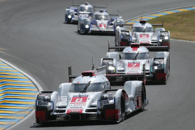 The Audi R18 E-TRON Quattro No8 of the Audi Sport Team Joest driven by Lucas Di Grassi of Brazil, Loic Duval of France and Britain's Oliver Jarvis is seen in action during the 83rd 24-hour Le Mans endurance race, in Le Mans, western France, Saturday, June 13, 2015. (AP Photo/David Vincent)
