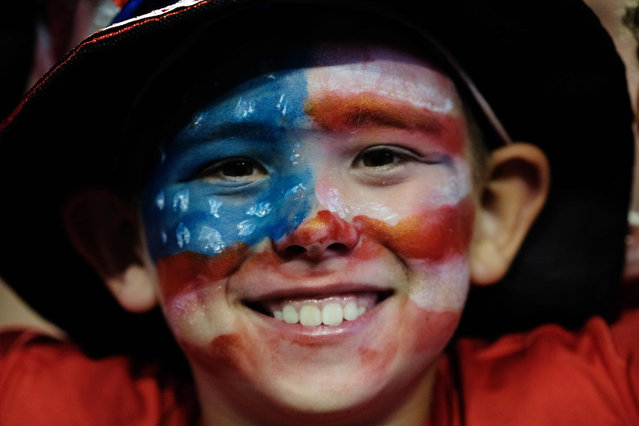 A young USA fan smiles ahead of the 2019 Concacaf Gold Cup semifinal football match between USA and Jamaica on July 3, 2019 in Nashville, Tennessee. (Photo by Ricardo Arduengo/AFP Photo)