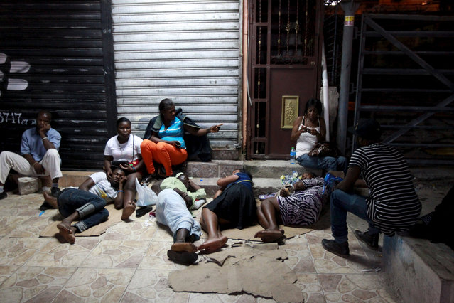 "Haitians sleep on the street outside the Ministry of Interior and Police while waiting to register in Santo Domingo June 17, 2015. A deadline for enforcement of a new immigration law on Wednesday night is raising fears in the Dominican Republic of mass deportations of thousands of Haitian migrants as well as stateless Dominicans of Haitian descent. Dominican officials say anyone lacking proper identity documents or who has not registered for a so-called ""regularization"" program before the deadline could face deportation. REUTERS/Ricardo Rojas"