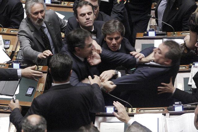 Claudio Barbato (L), a member of the opposition FLI party, fights with Fabio Ranieri (R) from the Northern League in Parliament in Rome October 26, 2011. (Photo by Giuseppe Lami/Reuters)