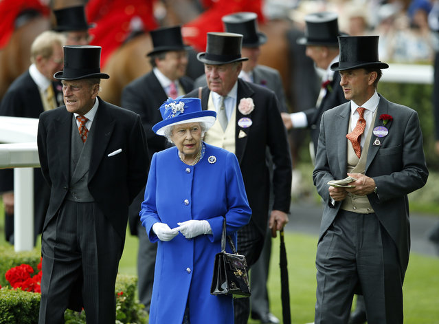 Britain's Queen Elizabeth II and Prince Philip, the Duke of Edinburgh, left, walk in the paddock on the second day of Royal Ascot horse racing meet at Ascot, England, Wednesday, June 17, 2015. Royal Ascot is the annual five day horse race meeting that Britain's Queen Elizabeth II attends every day of the event. (AP Photo/Alastair Grant)
