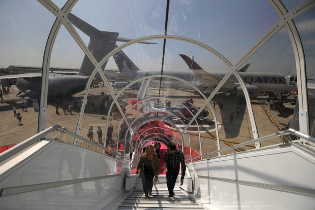 Visitors climb the staircase to the Airbus A380 of Qatar Airways presented at the Paris Air Show, in Le Bourget airport, north of Paris, Wednesday, June 17, 2015. Some 300,000 aviation professionals and spectators are expected at this week's Paris Air Show, coming from around the world to make business deals and see dramatic displays of aeronautic prowess and the latest air and space technology. (AP Photo/Francois Mori)