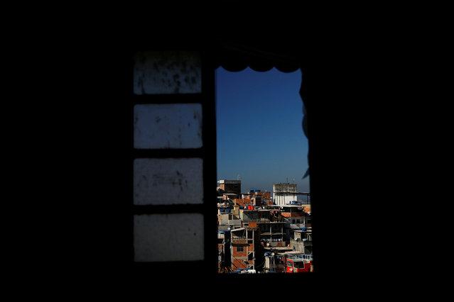 Houses are seen through a window of Tiki hostel in Cantagalo favela, in Rio de Janeiro, Brazil, April 16, 2016. (Photo by Pilar Olivares/Reuters)